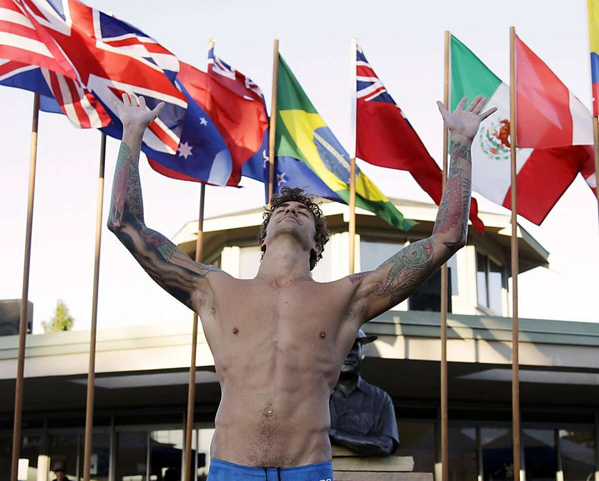 Anthony Ervin celebrates on the podium after his win in the 50-meter freestyle swimming final during the Santa Clara International Grand Prix, Saturday, June 2, 2012, in Santa Clara, Calif. (AP Photo/Marcio Jose Sanchez)