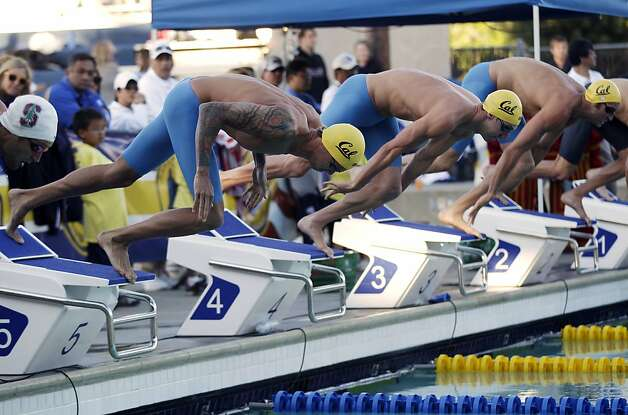 From left, Anthony Ervin, William Copeland and Clark Bennett compete in the 50-meter freestyle swimming final during the Santa Clara International Grand Prix, Saturday, June 2, 2012, in Santa Clara, Calif. Ervin won the race. (AP Photo/Marcio Jose Sanchez) Photo: Marcio Jose Sanchez, Associated Press