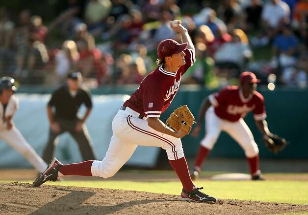 Stanford's Brett Mooneyham pitches on Saturday. Stanford played Pepperdine at Sunken Diamond on Saturday for the 2nd NCAA Regional game. Photo: Kevin Johnson, The Chronicle