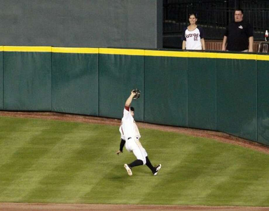 Astros center fielder Jordan Schafer catches a fly ball during the eighth inning. (James Nielsen / Chronicle)