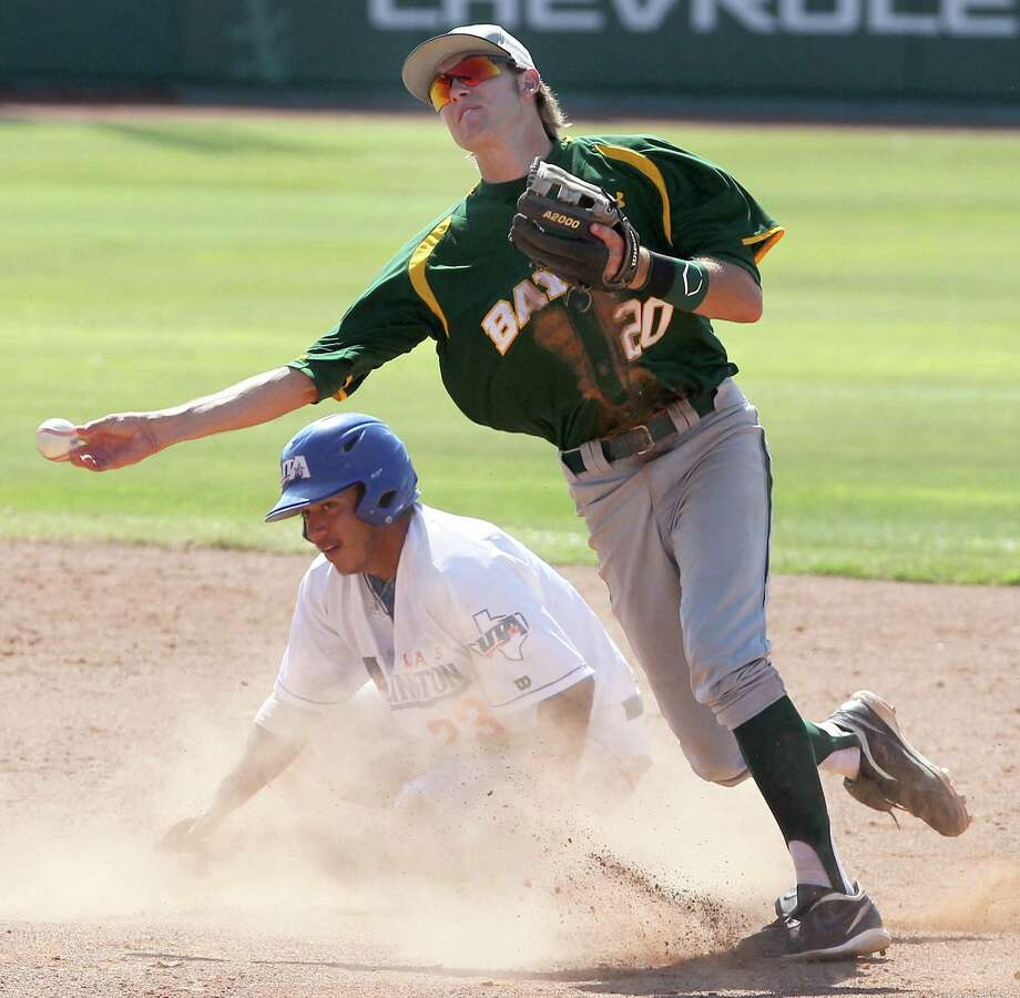 Baylor's Jake Miller (right) forces out Texas-Arlington's Michael Guerra at second as he tries to convert a double play. The Bears will face Oral Roberts at 2 p.m. today. Photo: AP