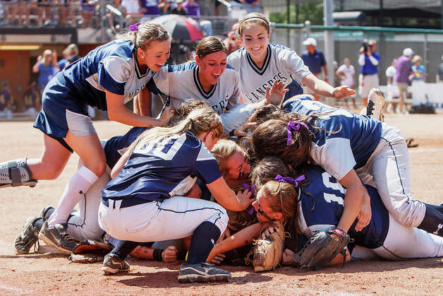 The Smithson Valley softball team piles on first baseman Taylor Darilek after she made the final out to win their 4A state final game with Montgomvery at McCombs Field in Austin on June 2, 2012.  Smithson Valley led from the start and held on to win the game 9-8.  MARVIN PFEIFFER/ mpfeiffer@express-news.net Photo: MARVIN PFEIFFER, Express-News / Express-News 2012