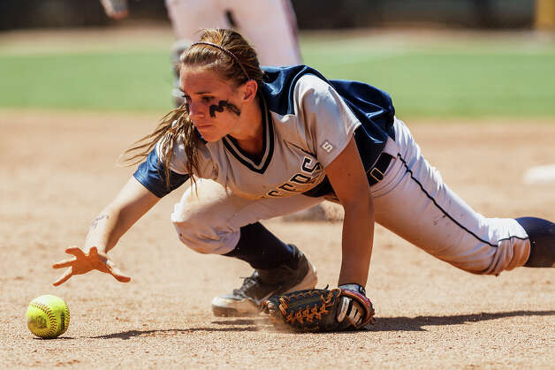 Smithson Valley second baseman Megan Hill reaches to make a play on a ball during the fifth inning of their 4A state final game with Montgomery at McCombs Field in Austin on June 2, 2012.  Smithson Valley won the game 9-8.  MARVIN PFEIFFER/ mpfeiffer@express-news.net Photo: MARVIN PFEIFFER, Express-News / Express-News 2012