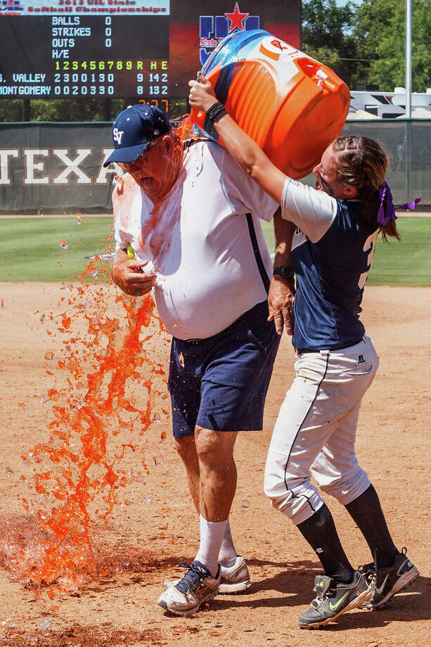 Smithson Valley's Katie Repoled douses assistant coach Wayne Daigle with gatorade following their during their 4A state final game with Montgomery at McCombs Field in Austin on June 2, 2012.  Smithson Valley won the game 9-8.  MARVIN PFEIFFER/ mpfeiffer@express-news.net Photo: MARVIN PFEIFFER, Express-News / Express-News 2012