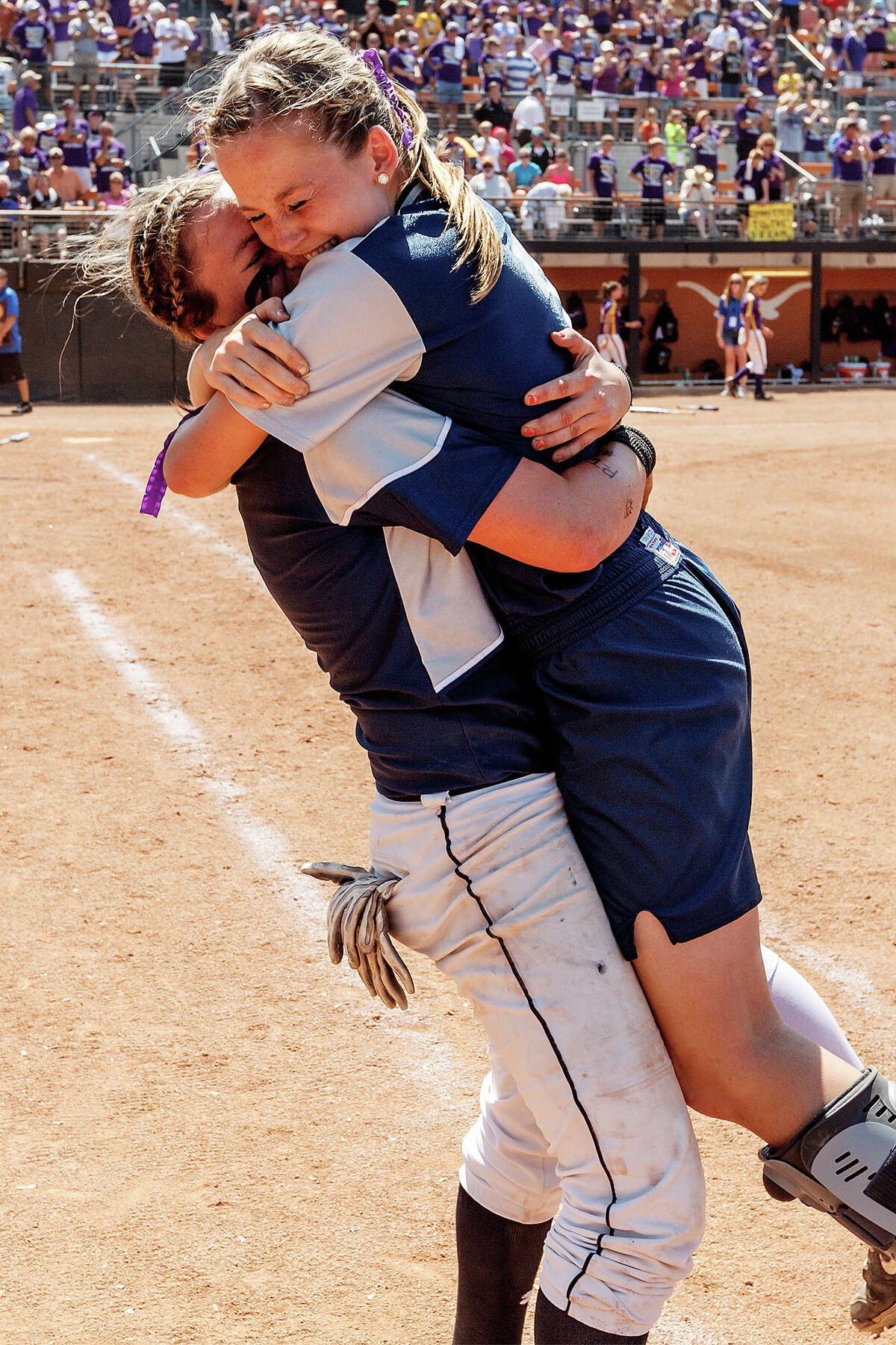 Smithson Valley's Repole twins, Katie (left) and Whitney (right) embrace as they celebrate their 4A state final championship folloowing their game with Montgomery at McCombs Field in Austin on June 2, 2012. Smithson Valley won the game 9-8. MARVIN PFEIFFER/ mpfeiffer@express-news.net