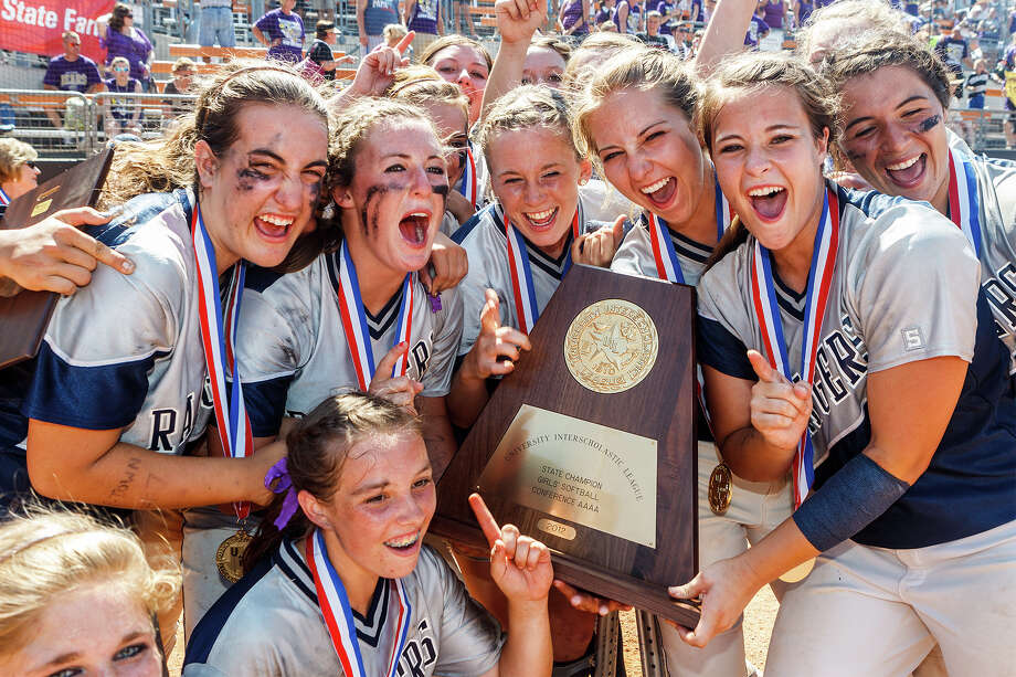 The Smithson Valley softball team celbrates with their state championship trophy following their 4A state final game with Montgomery at McCombs Field in Austin on June 2, 2012.  Smithson Valley led from the start and held on to win the game 9-8.  MARVIN PFEIFFER/ mpfeiffer@express-news.net Photo: MARVIN PFEIFFER, Express-News / Express-News 2012