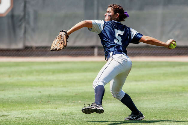 Smithson Valley center fielder Kellen Robles prepares to throw the ball to second during the sixth inning of their 4A state final game with Montgomery at McCombs Field in Austin on June 2, 2012.  Smithson Valley won the game 9-8.  Robles was named the MVP of the game.  MARVIN PFEIFFER/ mpfeiffer@express-news.net Photo: MARVIN PFEIFFER, Express-News / Express-News 2012