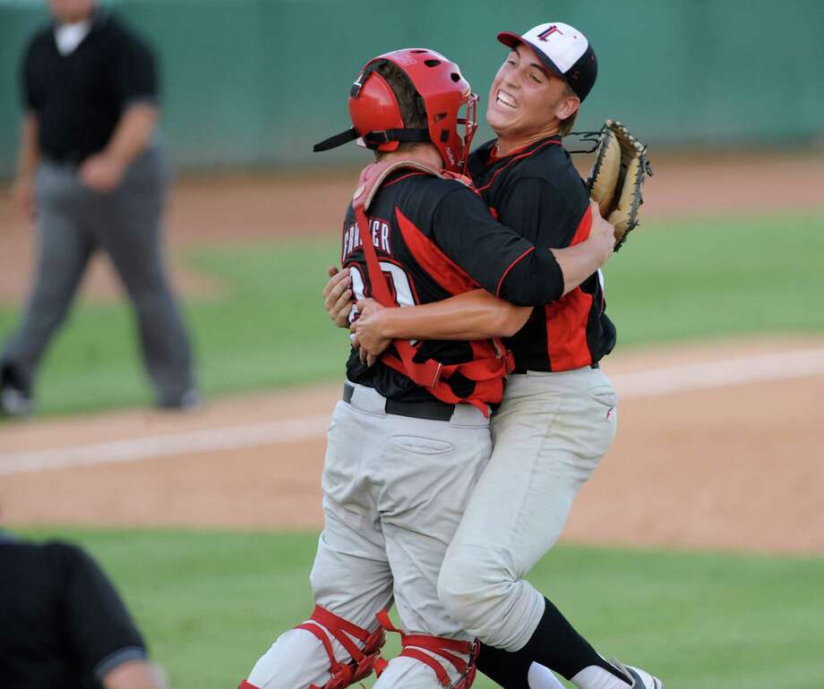 Lake Travis relief pitcher Daniel Castano and catcher Konner Frazier celebrate after defeating Boerne Champion, 3-2, in extra innings during Class 4A regional finals baseball action at Wolff Stadium on Saturday, June 2, 2012. Photo: Billy Calzada, Express-News / © 2012 San Antonio Express-News