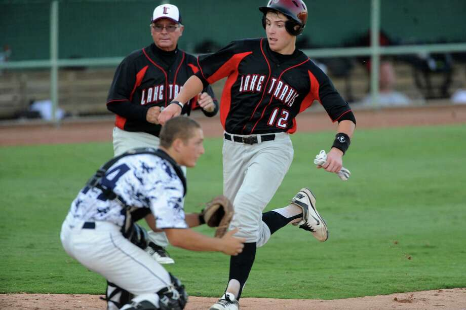 Baker Mayfield of Lake Travis scores what would turn out to be the winning run in the top of the 8th inning as they defeat Boerne Champion, 3-2, during Class 4A regional finals baseball action at Wolff Stadium on Saturday, June 2, 2012. Photo: Billy Calzada, Express-News / © 2012 San Antonio Express-News