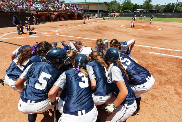 The Smithson Valley softball teams huddles together for a final time prior to their 4A state final game with Montgomery at McCombs Field in Austin on June 2, 2012.  Smithson Valley won the game 9-8.  MARVIN PFEIFFER/ mpfeiffer@express-news.net Photo: MARVIN PFEIFFER, Express-News / Express-News 2012