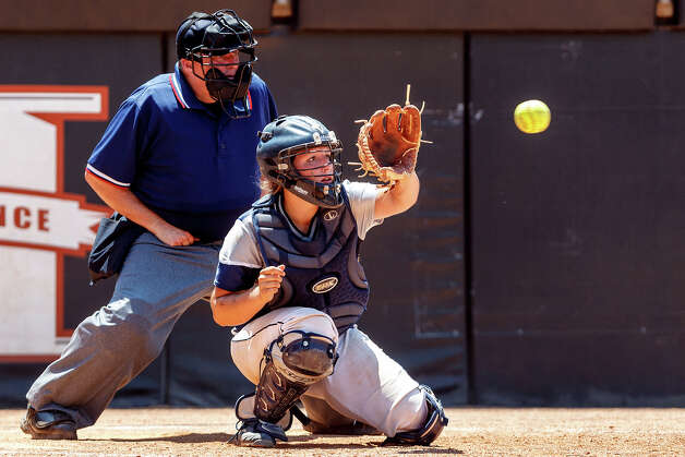 Smithson Valley catcher Clena Massey prepares to catch a pitch during their 4A state final game with Montgomery at McCombs Field in Austin on June 2, 2012.  Massey had two hits and three RBI's in the game to help Smithson Valley come away with a 9-8 victory and the state championship.  MARVIN PFEIFFER/ mpfeiffer@express-news.net Photo: MARVIN PFEIFFER, Express-News / Express-News 2012