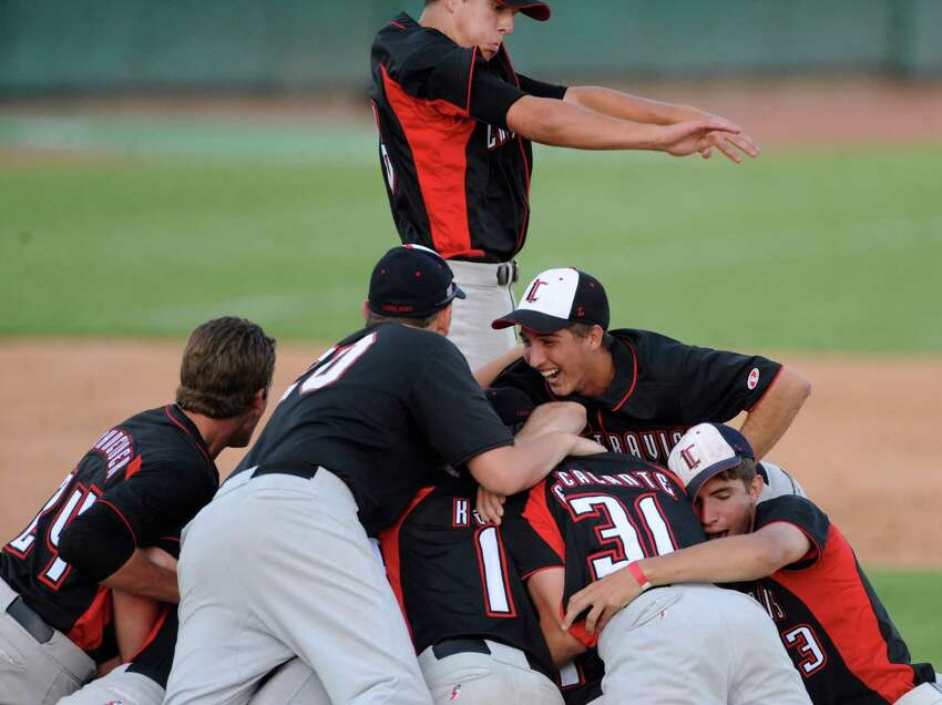 Lake Travis dogpiles on the mound after defeating Boerne Champion, 3-2, in Class 4A regional finals baseball action at Wolff Stadium on Saturday, June 2, 2012.