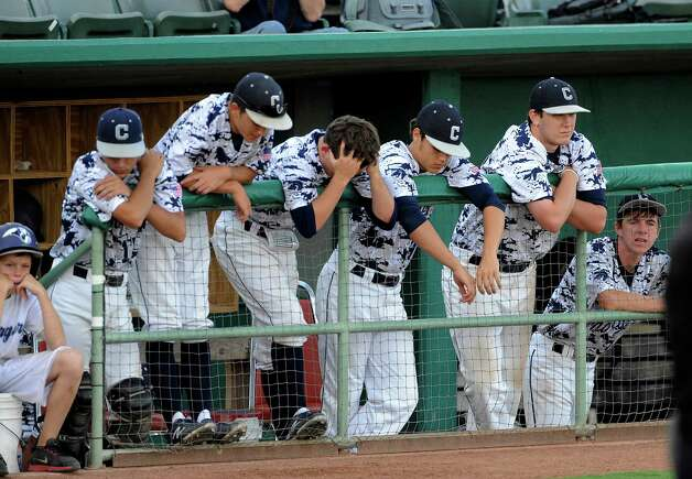 The Boerne Champion Chargers react as they drop their Class 4A regional finals baseball game, 3-2, against Lake Travis at Wolff Stadium on Saturday, June 2, 2012. Photo: Billy Calzada, Express-News / © 2012 San Antonio Express-News
