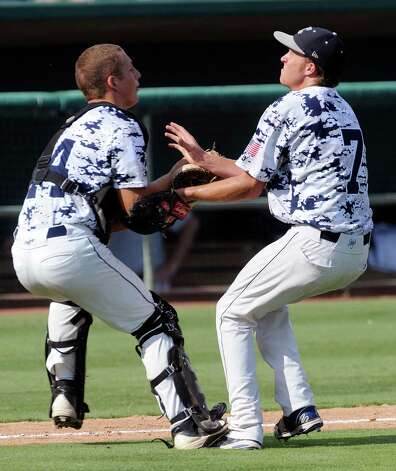 Boerne Champion catcher Jimmy Clarke catches a pop fly as pitcher Luke Strieber approaches during Class 4A regional finals baseball action at Wolff Stadium on Saturday, June 2, 2012. Photo: Billy Calzada, Express-News / © 2012 San Antonio Express-News
