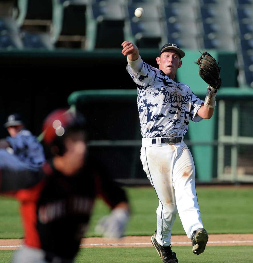 Boerne Champion third baseman Josh Holcomb successfully throws out a Lake Travis runner during Class 4A regional finals baseball action at Wolff Stadium on Saturday, June 2, 2012. Photo: Billy Calzada, Express-News / © 2012 San Antonio Express-News