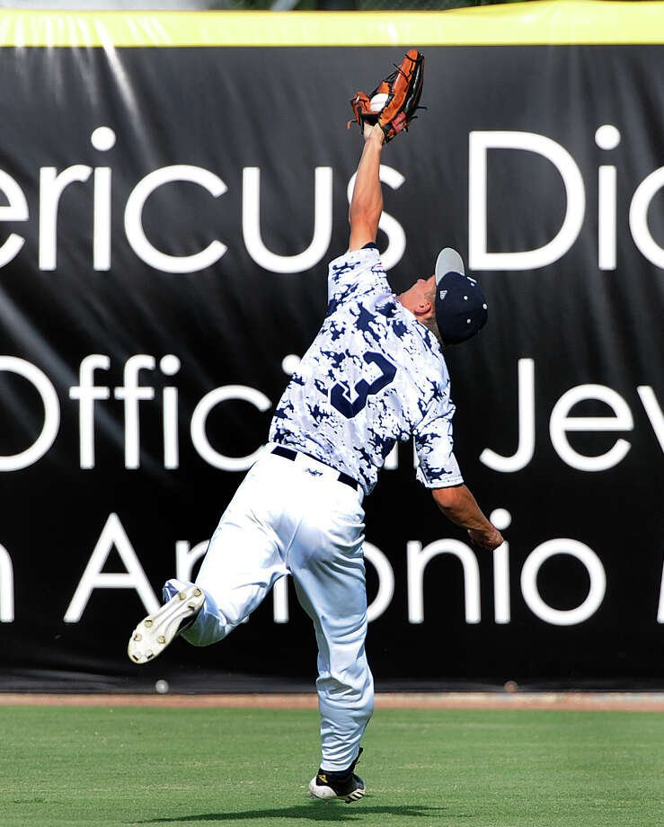 Boerne Champion centerfielder Austin Ley makes a running catch of a long fly ball during Class 4A regional finals baseball action against Lake Travis at Wolff Stadium on Saturday, June 2, 2012. Photo: Billy Calzada, Express-News / © 2012 San Antonio Express-News