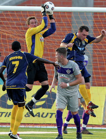 Scorpion goalkeeper Daryl Sattler pulls down a shot in the first half as the San Antonio Scorpions play the Minnesota Stars at Heroes Stadium on  June 2, 2012. Photo: Tom Reel, Express-News / ©2012 San Antono Express-News