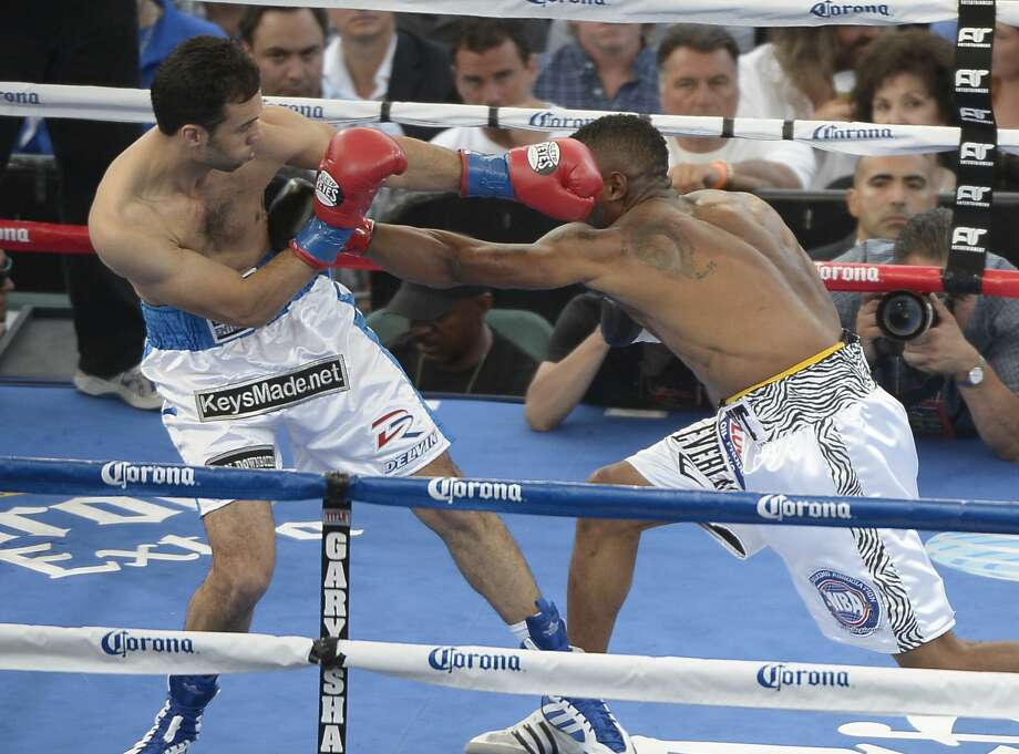 JUNE 2,2012. Carson CA.  Delvin Rodriguez (In white/Blue trunks)from Danbury CT, goes takes on Austin Trout from Las Cruces NM for the WBA super welterweight title at the Home Depot center  Saturday night. Photo by Gene Blevins/LA Daily News