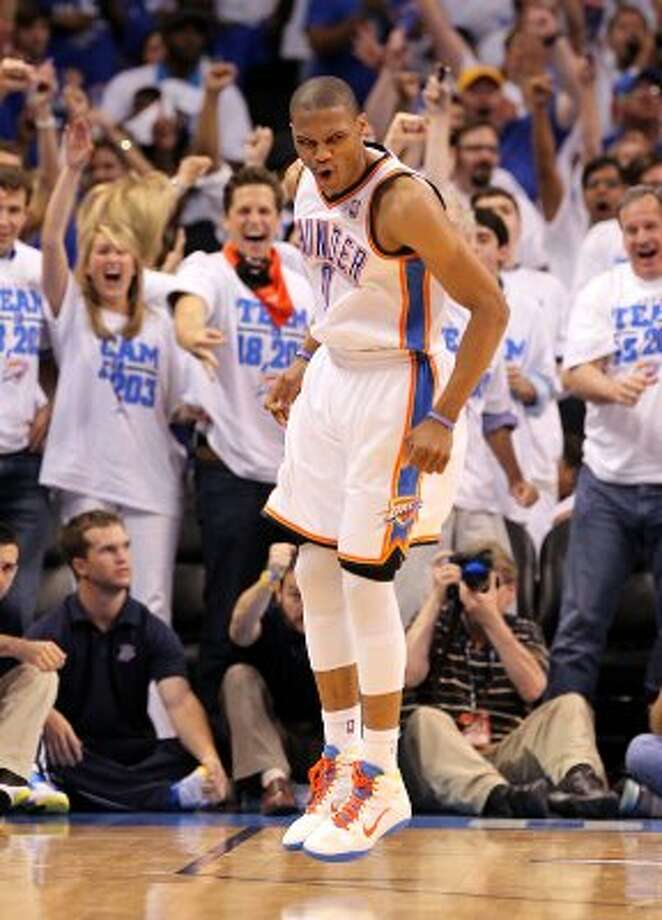 Oklahoma City Thunder's Russell Westbrook (0) reacts after a basket during the first half of game four of the NBA Western Conference Finals in Oklahoma City, Okla. on Saturday, June 2, 2012. (Kin Man Hui / San Antonio Express-News)