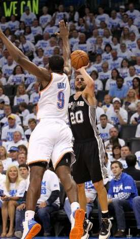 San Antonio Spurs' Manu Ginobili (20) shoots against Oklahoma City Thunder's Serge Ibaka (9) during the first half of game four of the NBA Western Conference Finals in Oklahoma City, Okla. on Saturday, June 2, 2012. (Kin Man Hui / San Antonio Express-News)