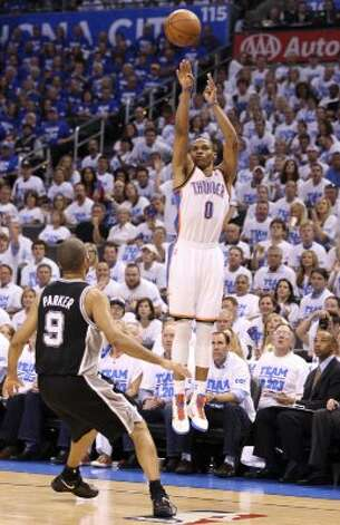 Oklahoma City Thunder's Russell Westbrook (0) shoots over San Antonio Spurs' Tony Parker (9) during the first half of game four of the NBA Western Conference Finals in Oklahoma City, Okla. on Saturday, June 2, 2012. (Edward A. Ornelas / San Antonio Express-News)