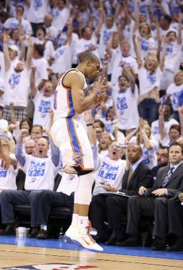 Oklahoma City Thunder's Russell Westbrook (0) reacts after hitting a three point basket during the first half of game four of the NBA Western Conference Finals in Oklahoma City, Okla. on Saturday, June 2, 2012. (Edward A. Ornelas / San Antonio Express-News)