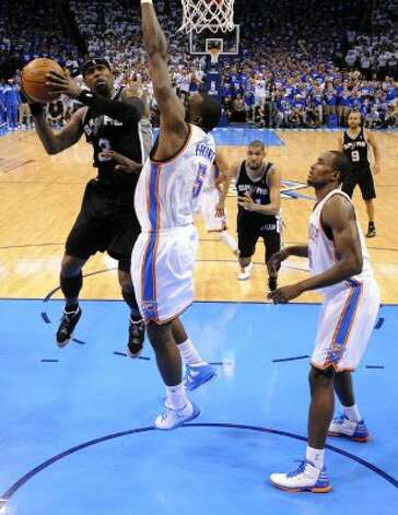 San Antonio Spurs' Stephen Jackson (3) shoots against Oklahoma City Thunder's Kendrick Perkins (5) during the first half of game four of the NBA Western Conference Finals in Oklahoma City, Okla. on Saturday, June 2, 2012. (Edward A. Ornelas / San Antonio Express-News)