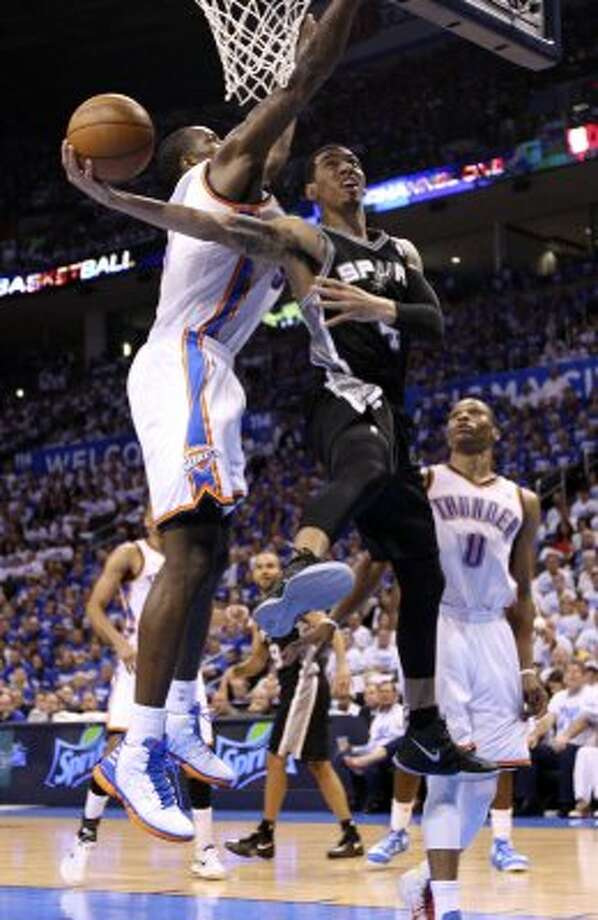 San Antonio Spurs' Danny Green (4) shoots around Oklahoma City Thunder's Serge Ibaka (9) during the second half of game four of the NBA Western Conference Finals in Oklahoma City, Okla. on Saturday, June 2, 2012. (Edward A. Ornelas / San Antonio Express-News)