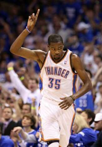 Oklahoma City Thunder's Kevin Durant (35) points after scoring during the second half of game four of the NBA Western Conference Finals in Oklahoma City, Okla. on Saturday, June 2, 2012. (Edward A. Ornelas / San Antonio Express-News)