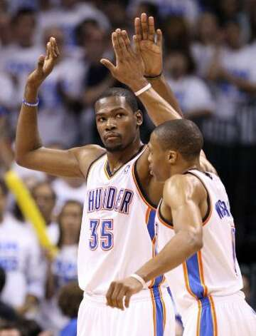 Oklahoma City Thunder's Kevin Durant (35) high fives Oklahoma City Thunder's Russell Westbrook (0) during the second half of game four of the NBA Western Conference Finals in Oklahoma City, Okla. on Saturday, June 2, 2012. (Edward A. Ornelas / San Antonio Express-News)