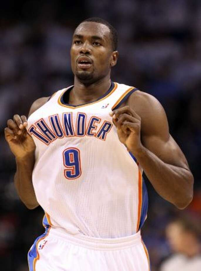 Oklahoma City Thunder's Serge Ibaka (9) holds out his jersey during the second half of game four of the NBA Western Conference Finals in Oklahoma City, Okla. on Saturday, June 2, 2012. (Edward A. Ornelas / San Antonio Express-News)