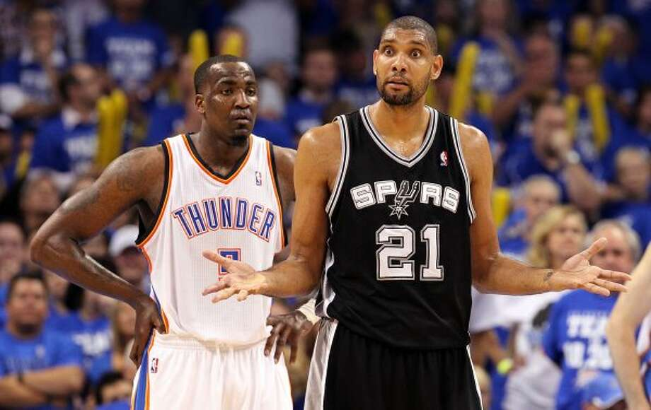 San Antonio Spurs' Tim Duncan (21) gestures in front of Oklahoma City Thunder's Kendrick Perkins (5) during the second half of game four of the NBA Western Conference Finals in Oklahoma City, Okla. on Saturday, June 2, 2012. (Kin Man Hui / San Antonio Express-News)