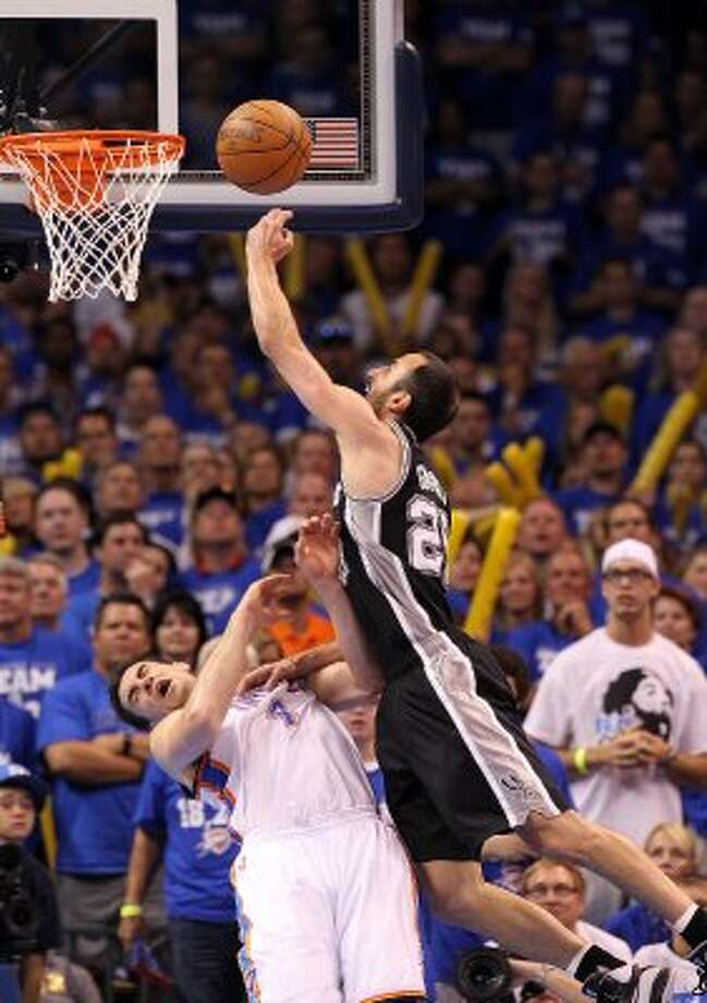 San Antonio Spurs' Manu Ginobili (20) draws a charging call while going for a basket against Oklahoma City Thunder's Nick Collison (4) during the second half of game four of the NBA Western Conference Finals in Oklahoma City, Okla. on Saturday, June 2, 2012. (Kin Man Hui / San Antonio Express-News)