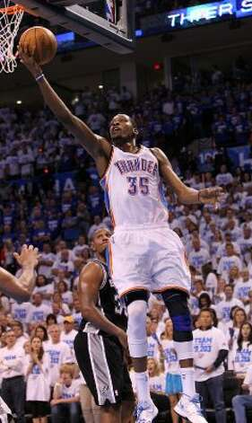Oklahoma City Thunder's Kevin Durant (35) lays the ball in during the second half of game four of the NBA Western Conference Finals in Oklahoma City, Okla. on Saturday, June 2, 2012. (Kin Man Hui / San Antonio Express-News)