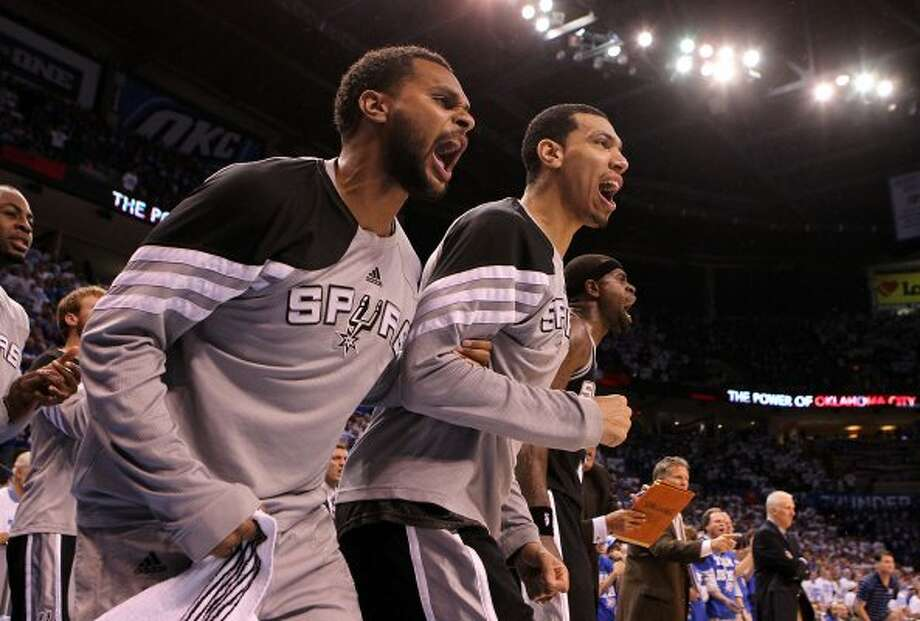 San Antonio Spurs' Patty Mills, left, and San Antonio Spurs' Danny Green (4) yell from the bench during the second half of game four of the NBA Western Conference Finals in Oklahoma City, Okla. on Saturday, June 2, 2012. (Kin Man Hui / San Antonio Express-News)