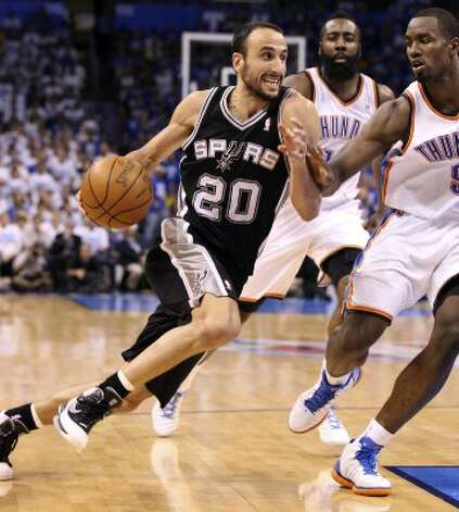 San Antonio Spurs' Manu Ginobili (20) drives against Oklahoma City Thunder's Serge Ibaka (9) during the second half of game four of the NBA Western Conference Finals in Oklahoma City, Okla. on Saturday, June 2, 2012. (San Antonio Express-News)