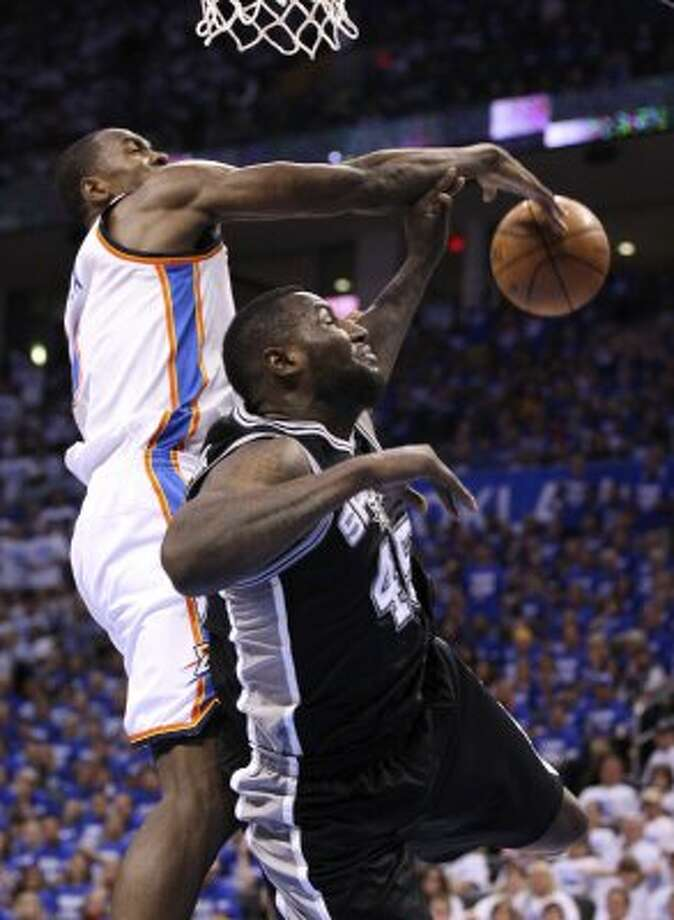 Oklahoma City Thunder's Serge Ibaka (9) blocks a shot by San Antonio Spurs' DeJuan Blair (45) during the second half of game four of the NBA Western Conference Finals in Oklahoma City, Okla. on Saturday, June 2, 2012. (San Antonio Express-News)