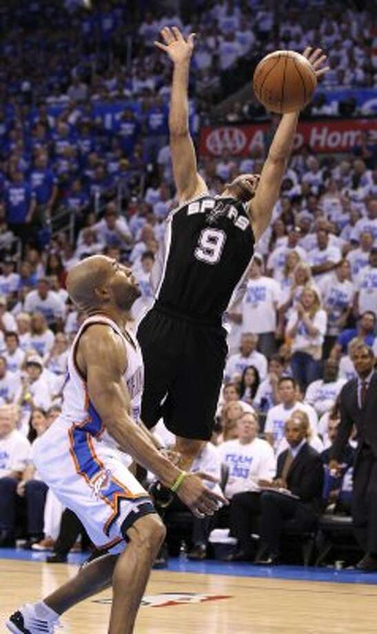 San Antonio Spurs' Tony Parker (9) loses control of the ball near Oklahoma City Thunder's Derek Fisher (37) during the second half of game four of the NBA Western Conference Finals in Oklahoma City, Okla. on Saturday, June 2, 2012. (San Antonio Express-News)