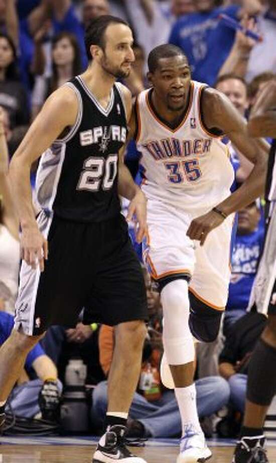 Oklahoma City Thunder's Kevin Durant (35) runs past San Antonio Spurs' Manu Ginobili (20) after scoring during the second half of game four of the NBA Western Conference Finals in Oklahoma City, Okla. on Saturday, June 2, 2012. (San Antonio Express-News)