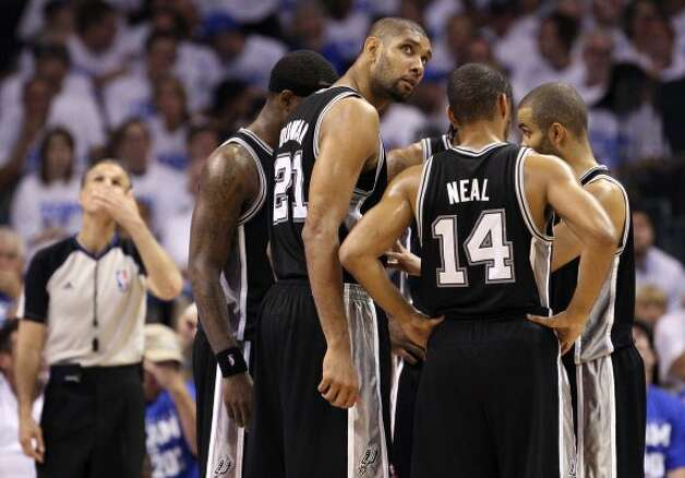 San Antonio Spurs' Tim Duncan (21) looks out from the huddle during the second half of game four of the NBA Western Conference Finals in Oklahoma City, Okla. on Saturday, June 2, 2012. (San Antonio Express-News)