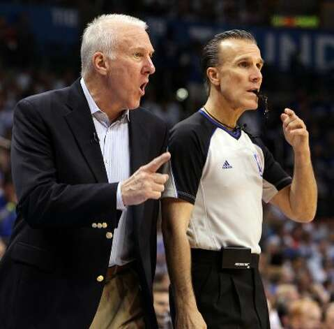 San Antonio Spurs coach Gregg Popovich talks to official Ed Malloy during the second half of game four of the NBA Western Conference Finals in Oklahoma City, Okla. on Saturday, June 2, 2012. (San Antonio Express-News)