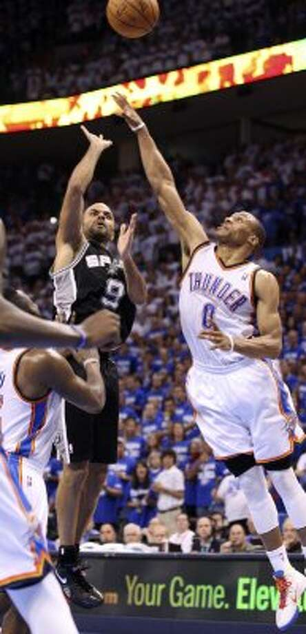 San Antonio Spurs' Tony Parker (9) shoots over Oklahoma City Thunder's Russell Westbrook (0) during the second half of game four of the NBA Western Conference Finals in Oklahoma City, Okla. on Saturday, June 2, 2012.  The Thunder won 109-103. (San Antonio Express-News)
