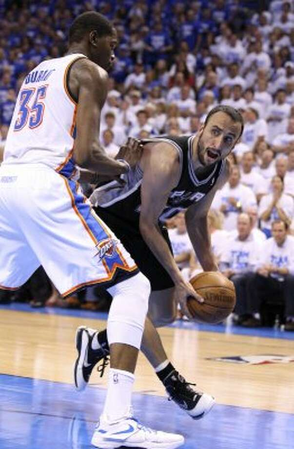 San Antonio Spurs' Manu Ginobili (20) looks to pass over Oklahoma City Thunder's Kevin Durant (35) during the second half of game four of the NBA Western Conference Finals in Oklahoma City, Okla. on Saturday, June 2, 2012.  The Thunder won 109-103. (San Antonio Express-News)