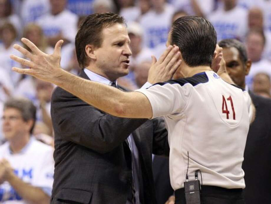 Oklahoma City Thunder coach Scott Brooks talks to official Ken Mauer during the second half of game four of the NBA Western Conference Finals in Oklahoma City, Okla. on Saturday, June 2, 2012.  The Thunder won 109-103. (San Antonio Express-News)