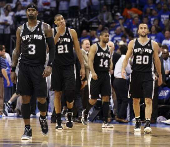 San Antonio Spurs' Stephen Jackson (3), San Antonio Spurs' Tim Duncan (21) and San Antonio Spurs' Manu Ginobili (20) walk on the court  during the second half of game four of the NBA Western Conference Finals in Oklahoma City, Okla. on Saturday, June 2, 2012.  The Thunder won 109-103. (San Antonio Express-News)
