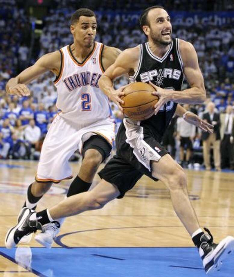 Spurs' Manu Ginobili drives around Thunder's Thabo Sefolosha during the second half of game four of the NBA Western Conference Finals in Oklahoma City, Okla. on Saturday, June 2, 2012. (San Antonio Express-News)
