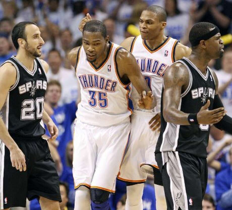 Thunder's Russell Westbrook celebrates with teammate Thunder's Kevin Durant after he scored as Spurs' Manu Ginobili and Spurs' Stephen Jackson look on during the second half of game four of the NBA Western Conference Finals in Oklahoma City, Okla. on Saturday, June 2, 2012. (San Antonio Express-News)