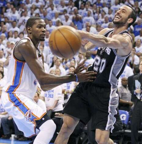 San Antonio Spurs' Manu Ginobili (20) passes around Oklahoma City Thunder's Kevin Durant (35) during the second half of game four of the NBA Western Conference Finals in Oklahoma City, Okla. on Saturday, June 2, 2012.  The Thunder won 109-103. (San Antonio Express-News)