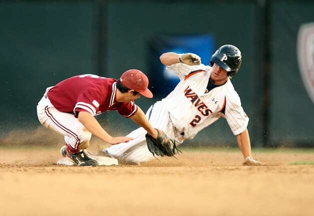 Pepperdine's Matt Gelalich slides into second base and attempts to avoid a tag. Stanford met Pepperdine at Sunken Diamond on Saturday for the 2nd NCAA Regional game. Photo: Kevin Johnson, The Chronicle