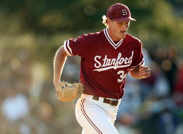 Brett Mooneyham returns to the dugout after being replaced on the mound on Saturday during the NCAA regional versus Pepperdine. Stanford met Pepperdine at Sunken Diamond on Saturday for the 2nd NCAA Regional game. Photo: Kevin Johnson, The Chronicle